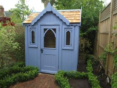 Bespoke gothic with cedar roof painted with sadolin wild grape