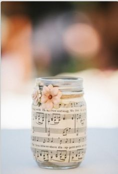 Mason jar DIY. Wrap in music sheet of your choice then pop in a candle and watch the music glow! Viola !!!