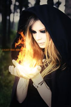 "A black hood was pulled securely over her head, shadowing her face from the world. ""You don't know the half of it."" My eyes widened in shock as fire danced between her slender fingers."