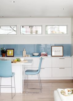 blue backsplash + picture windows