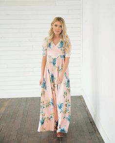 This Blake Pink Floral Maxi Wrap Dress is a dream come true! The gorgeous floral print features light pink base that is accented with Hawaiian inspired flowers and greenery. You will be looking for any excuse to show this wrap dress off.  This dress is perfect for anything from a casual date night to a black tie affair. || Bella Ella Boutique