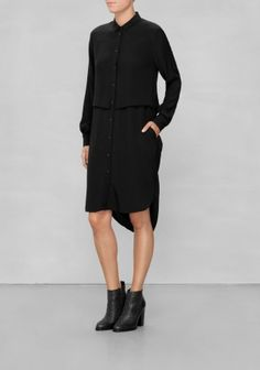 This lightweight dress combines the classic button-down style with a modern layer-effect front and dipped hem for an updated go-everywhere look.