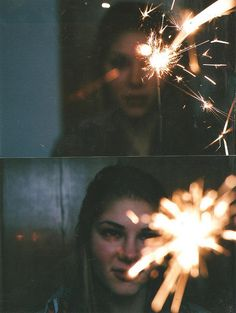 Sparklers by Natalie Moonbeam, via Flickr