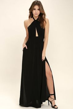 All eyes will be on you in the Watch Me Black Maxi Dress! Gauzy rayon drapes into a halter bodice with adjustable strap that loops through a keyhole at the neck, and ties at back. A fitted waistline accentuates your figure before flowing into a full, maxi skirt with sexy side slit. Side seam pockets. Hidden back zipper/clasp.