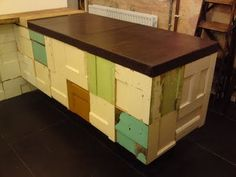 Not sure what i think of this, but i saw this done with the fronts of vintage suitcases and I loved it. Sabe