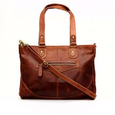 This structured handbag is made from beautiful thick leather which has a wonderful supple feel. The leather is a full grain oiled leather which is characterised by its authentic vintage appearance. It holds its shape so is perfect if you prefer a more constructed look. Ideal for everyday use, the purse is large enough for the daily essentials, including a tablet/iPad.  Features one main compartment inside zip closure two carry handles detachable adjustable shoulder strap fully lined mobile…