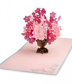 Paper pop up card full of flowers! Brighten her day with LovePop's pink Ornate Floral Bouquet.
