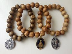 Wooden Bead Bracelets with Religious Charms by BeadJunkie1 on Etsy