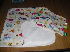 Made this lovely Baby Blanket with matching Taggie, it's so warm and cosy with bright and vibrant Colours.