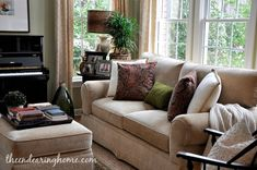 Living Room Makeover - The Endearing Home - I like the color of the sofa to soften dark woods