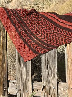 This incredibly soft wrap is an asymetric garter shawl with
