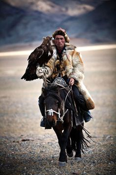 does it get any coller than this...a mongolian hunter, on a horse, with an eagle on his arm?????