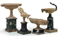A GROUP OF FOUR SIENA MARBLE, GIALLO ANTICO, VERDE ANTICO AND SPECIMEN MARBLE GRAND TOUR OBJECTS ITALIAN, 19TH CENTURY Two in the form of oil lamps, one lobed font and a three-basined font - 11 in. (28 cm.) high, the tallest (4)