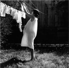 classic pregnancy image by joanne leonard, 1966..   Before this time period it was a wives tale you would loose the baby if u lifted ur arms above ur head.