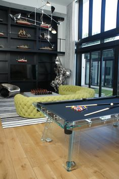 Contemporary design interior featuring an all glass billiard table by IMPATIA.