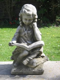 Figurines with reading theme - garden ornament