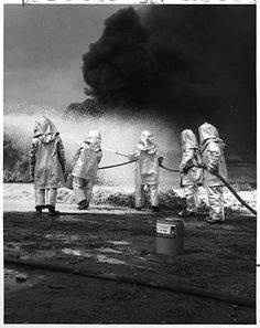 """Firemen use a 3M product """"light water"""" to put out an oil fire. 1968."""