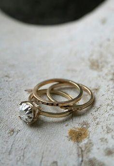 Gold engagement ring stacking