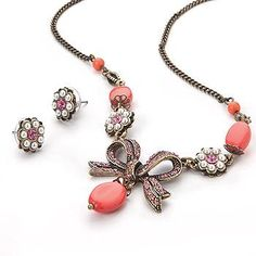Pinkstix- Coral Bow Necklace   This necklace is beautiful.  Great summer coral color. Only $12.50 Bow Necklace, Earrings, Coral Color, Bows, Store, Bracelets, Summer, Beautiful, Jewelry