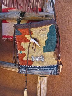 Vintage ethnic textile bag with bridle leather and southwest sterling silver