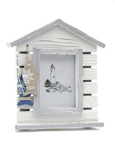 Quirky, nautical, lighthouse photo frame - great for your bedroom or perhaps even your bathroom! Find more nautical decor at Orchard Layne