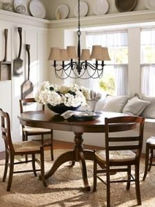 these burlap shades make me want to switch out all my black shades on the dining room chandy