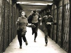 "Jeanne Moreau's Catherine, Oskar Werner's Jules, and Henri Serre's Jim on the railway bridge, racing. By Raymond Cauchetier. François Truffaut's ""Jules and Jim""."