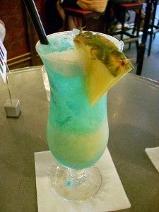 This drink is called the Swimming Pool:   1/4 oz heavy cream  3/4 oz cream of coconut  2 oz pineapple juice  3/4 oz vodka  1 1/2 oz Bacardi Light Rum  1/4 oz Blue Curacao liqueur  1 scoop crushed ice  1/4 Slice of pineappple Mix ingredients; except the blue curacao. Pour into a glass and float the blue curacao on top. Garnish with pineapple and serve with a straw.