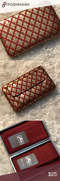 """1️⃣1️⃣H A N A N E L  WALLET H A N A N E L  WALLET  Perfect wallet for the gal on the go!  Colorful, compact and convenient. Sturdy metal frame with easy-open clasp. Multi-function interior accommodates ID photo window, credit card slots, cash, checkbook holder!    ⚜️Measurements are 7.5"""" length x 1"""" width x 4.5"""" height ⚜️Sleek, unique & chic wallet ⚜️Opens easily & lies flat to allow easy access ⚜️Zippered pouch ⚜️Pocket on the back of wallet ⚜️Bonus checkbook cover included Bags Wallets"""