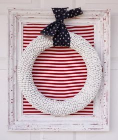 This shabby chic piece gets its whitewashed look from a pantry staple: dried white beans. Hot-glued en masse to a Styrofoam wreath form, the beans take on a pebble-like texture.
