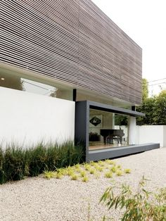 Interesting composition of wood, glass and plaster #architecture #modern
