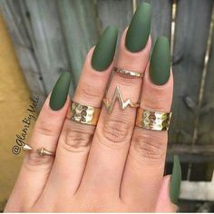 Olive green nails with gold rings