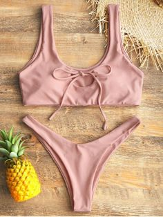 This super gorgeous two-piece bikini features a scoop collar top with self-tie details to the bust creating a sexy keyhole look, and coordinating briefs with a high cut leg on the thighs in a thong shape for its little coverage of hips. You may have a good time with this bikini on the beach. #Zaful #Swimwear #Bikinis