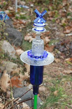 A must have for your garden!  Some repurposed glass garden art!