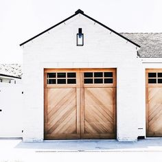 Transform and update the exterior of your home instantly by replacing garage doors with a more modern garage door design. We're showing you garage door styles to consider and what you need to think about when choosing modern garage door designs. House Design, House, Garage Doors, House Styles, Exterior Design, Modern Farmhouse Exterior, Modern Farmhouse, Painted Brick, Exterior