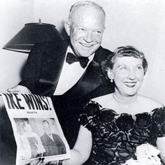 President Dwight D. Eisenhower and his wife, Mamie, hold up the front page of a newspaper in 1950 announcing his election victory.