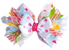 "A girl can never have too many precious hair bows. This hair bow adds a splash of individuality and a whole lot of color and style to a young girl's wardrobe. Hair bow size: approximately 5"" wide."