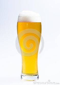 Close up of beer glass with foam isolated on white background.