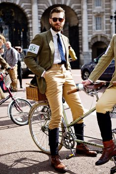 Guy posing on tandem bike for Tweed Run London 2015