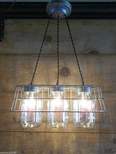 Convert a jar into a pendant light fixture. Check out the other 9 brilliant mason jar hacks #masonjar #ad