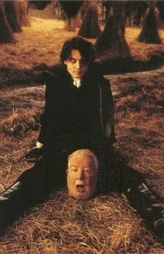 Johnny Depp and the 'Head' of Richard Griffiths on the set of Sleepy Hollow (1999)
