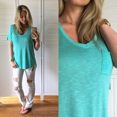 ▪️Aqua Pocket Tee Brand New, without tags. Size Small, Medium, and Large  available. Modeling Small. Semi-sheer, soft and stretchy and a cute front pocket. Same as many colors I have sold. 100% Rayon Tops Tees - Short Sleeve