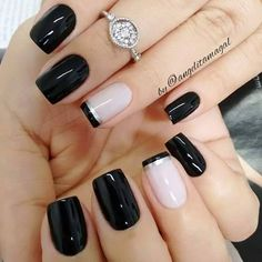 Black nails and light accent nail with black and silver stripes