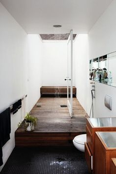 Inspiration from Bathrooms.com: Whether you have an open or retractable ceiling over your shower or just a huge roof window, the effect will be to turn a bathroom into a light-filled space.