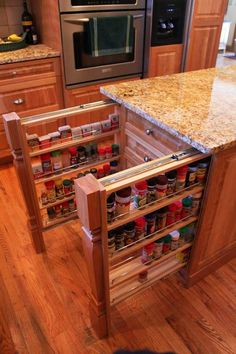 Hidden Kitchen Pull Out Storage Shelves in the Island. There is never enough room to pile them in the cabinet