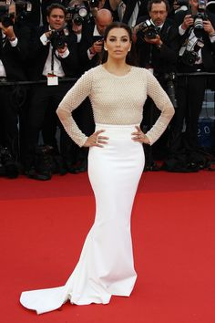 Eva Longoria stepped out for the Café Society premiere in an embellished long-sleeved top and fitted white ...