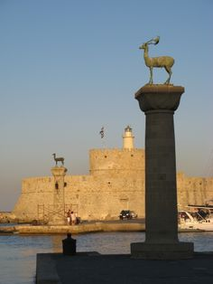 The harbor in old town on Rodos, Greece.  The pillars with deer represent where the Colossus of Rhodes is believed to have stood.