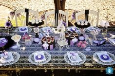Beautiful Paris themed tablescape. I like the use of hat boxes as dessert stands.