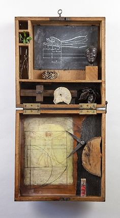 "Divine Proportions22.5""h X 13""w X 4.5""d - Antique box, antique slate, handmade paper, small replica sculpture of a Greek Kouros figure, da Vinci ""Vitruvian Man"", natural and antique elements, wax pencil, chalk, beeswax, resin, oil stick."
