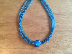A personal favourite from my Etsy shop https://www.etsy.com/listing/261229329/three-strand-necklace-with-blue